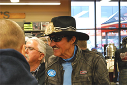 Former NASCAR driver Richard Petty greeting fans.